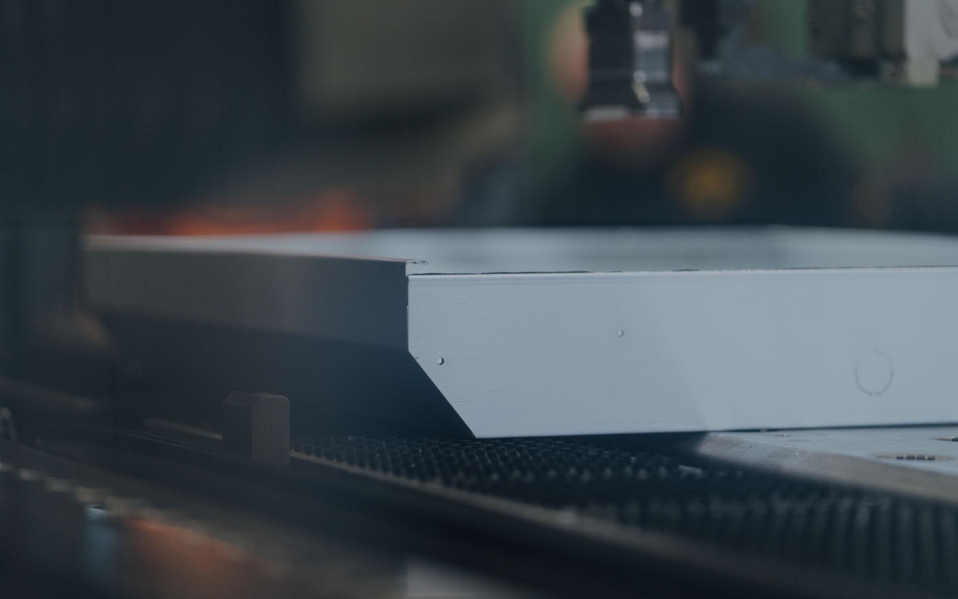 Giese Lighting worker manufacturing an LED light fixture